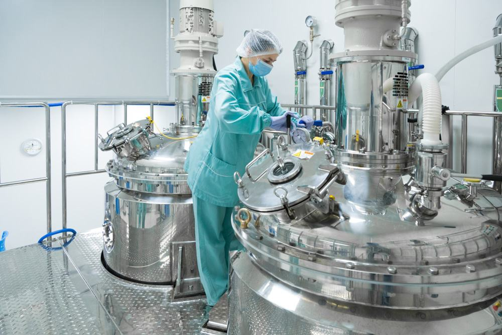 Employee working in with a pharmaceutical reactor